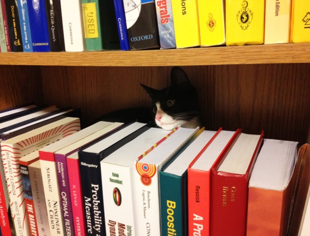 Tux in the bookshelf