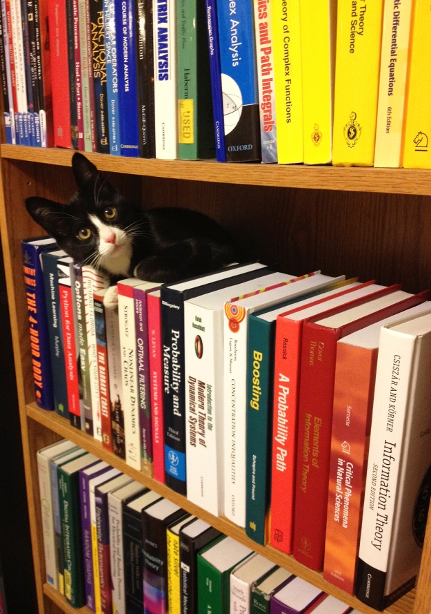 Tux leaning out of bookshelf