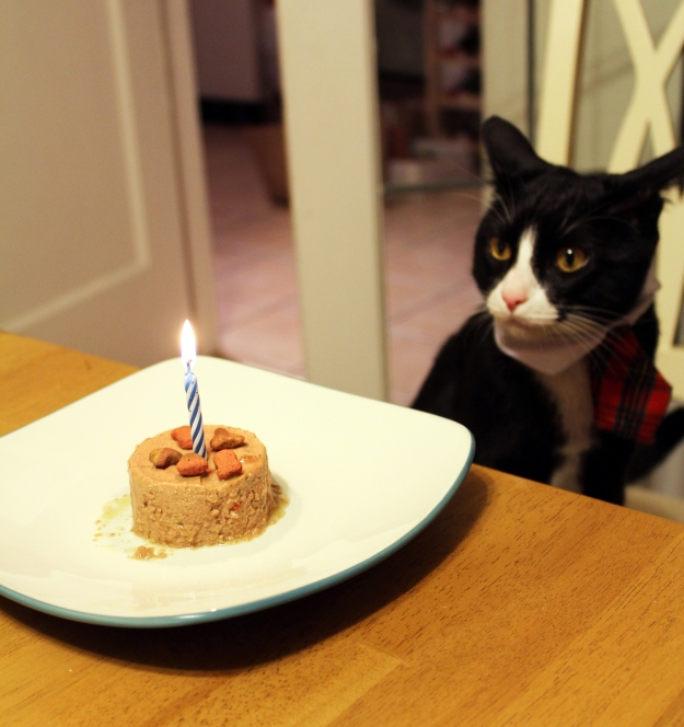Tux blowing out candle